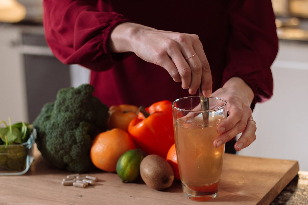 Vitamin C powder in water and vitamin C rich foods
