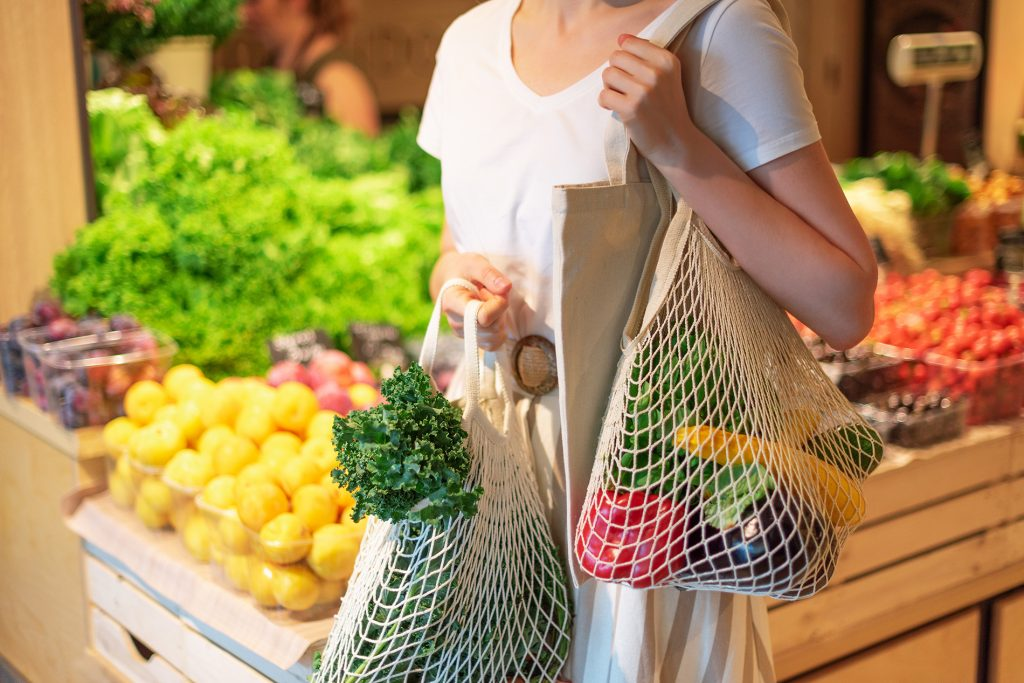 Woman shopping with reusable bags