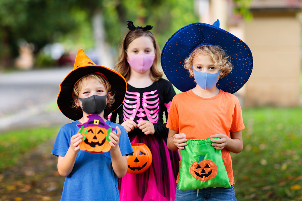 Kids trick or treating with masks on